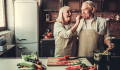 OlderCoupleSenior-couple-cooking-iStock-693323730