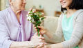 MothersDayGiving-senior-mother-flowers-iStock-517975386