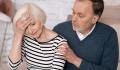 CaregiverManCaringForWomaniStock-667723992